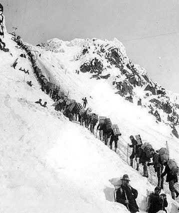 Miners and prospectors ascending summit of Chilkoot Pass, 1902